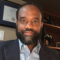 man with a beard wearing a business suit